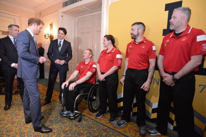 Prince Harry and Prime Minister Justin Trudeau greet Canadian athletes from the Invictus Games 2017